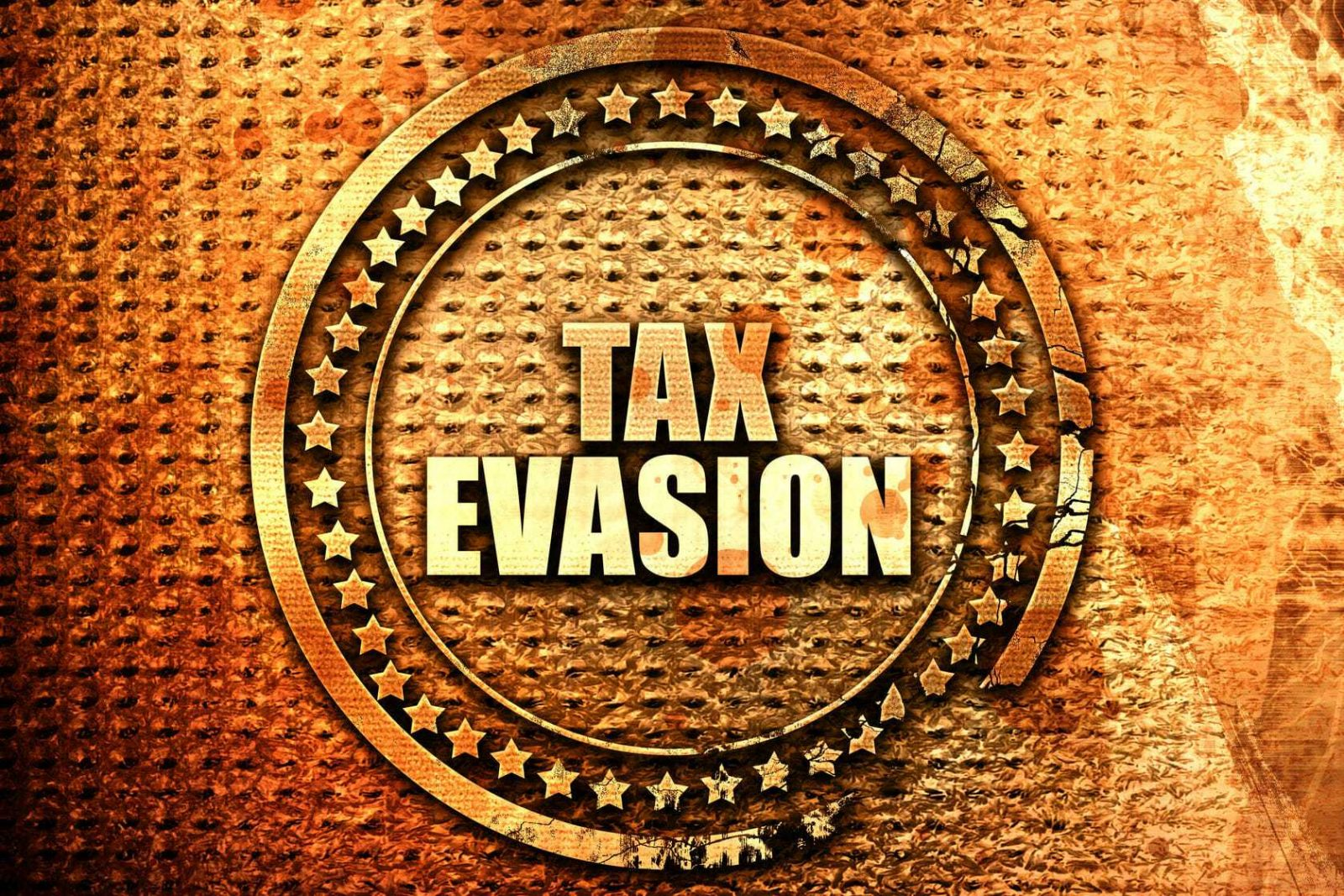 Husband Pleads Guilty to Tax Evasion - Wife's Charges Dropped